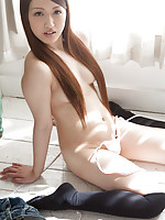 Cocoro Hirahara Asian takes long socks and shorts off for camera