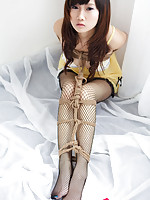 Miko Asian doll in fishnets has hands and boobies tied with ropes